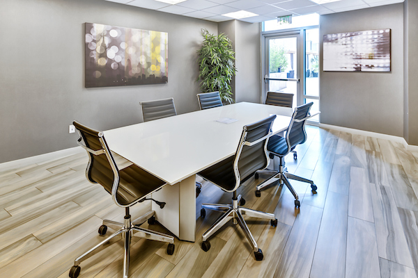 Shared work space with table and chairs.