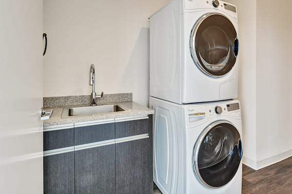 In-home washer and dryer next to sink.
