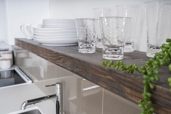 Wooden kitchen shelf with glassware
