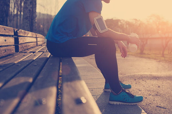 Runner sitting on a bench.