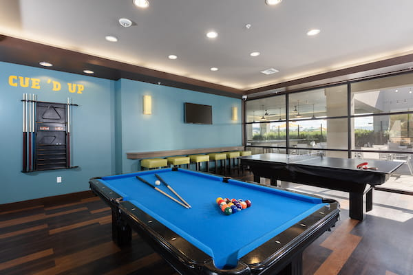 Club room with pool table, TV, and ping pong table.