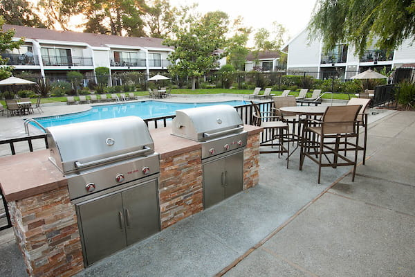BBQs next to the spa and swimming pool area.