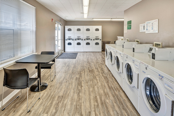 Onsite laundry room with five washers and eight dryers.