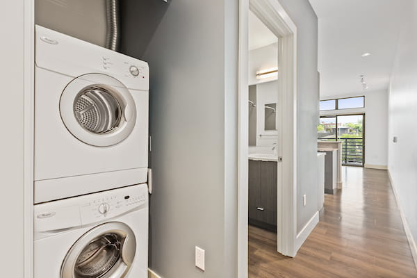 Hallway with In-Unit Washer and Dryer