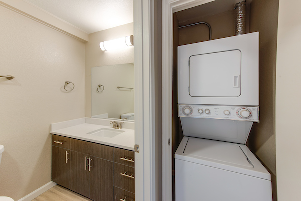 In-home washer and dryer in closet adjacent to bathroom.