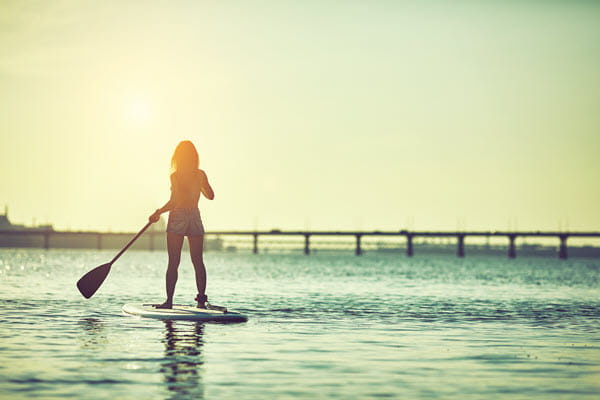 Woman paddleboarding.