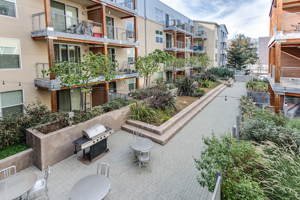 Elevated view of courtyard and exterior of apartment homes with lush landscaping.