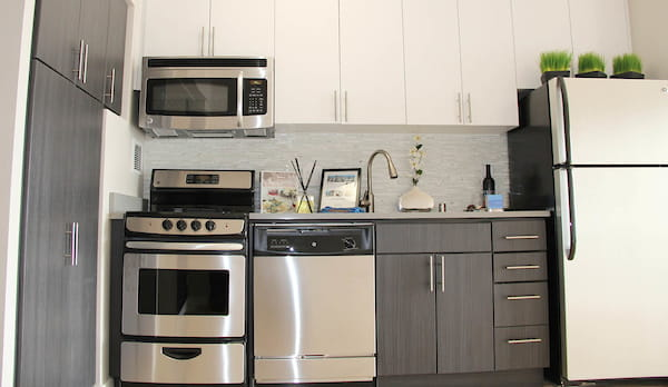 Staged kitchen with stainless steel appliances.