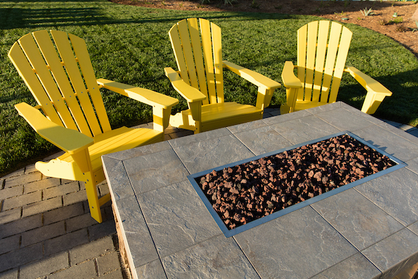 Outdoor firepit with chairs.