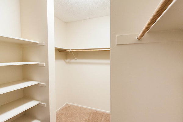 Large walk-in storage closet with shelving.