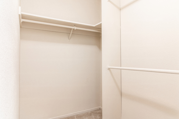 Closet with shelving and racks.
