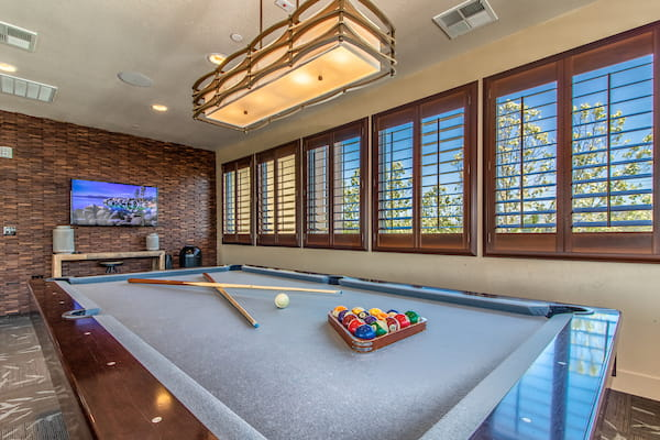 Lounge with pool table and TV.