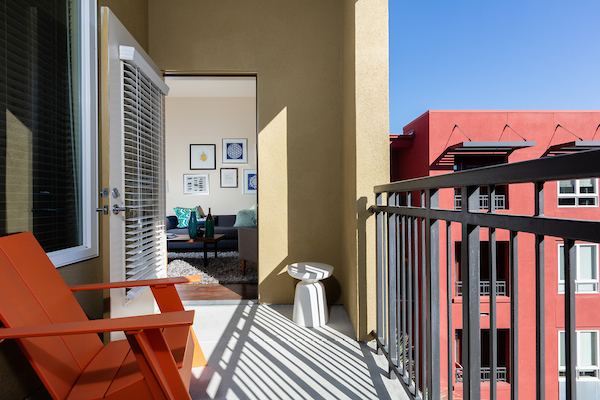 Apartment home balcony with chair.