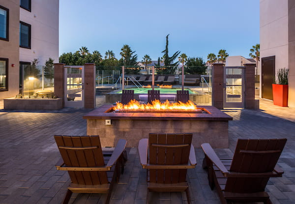 Outdoor firepit with lounge seating.