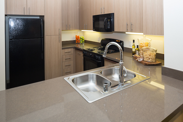 Staged kitchen with quartz countertops.