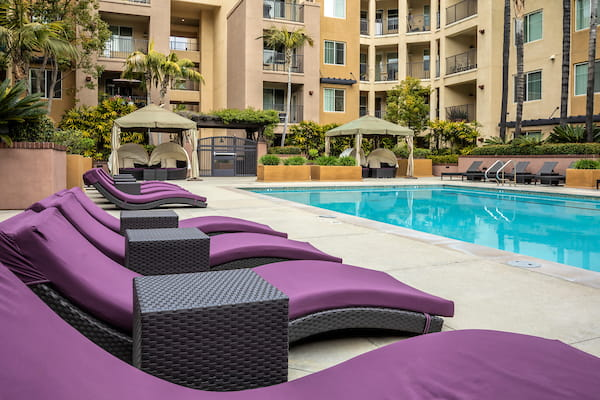 Outdoor swimming pool area with lounge seating.