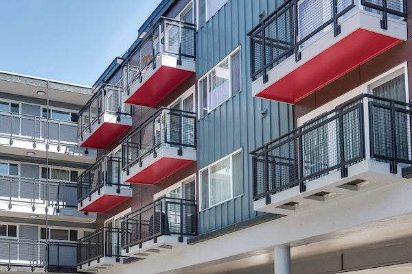 Exterior view of apartment building showcasing balconies.