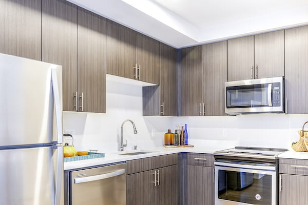 Staged kitchen with stainless steel appliances