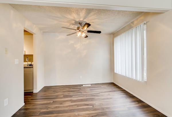 Room with fan and hardwood-style vinyl flooring