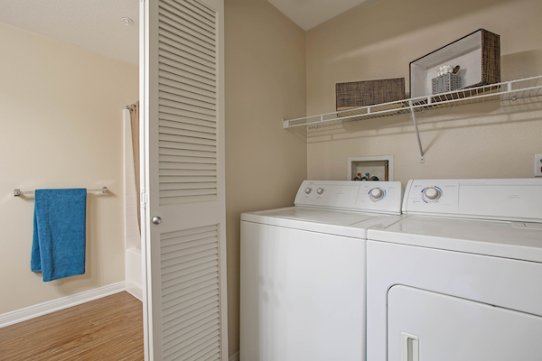 Staged in-home washer dryer unit.