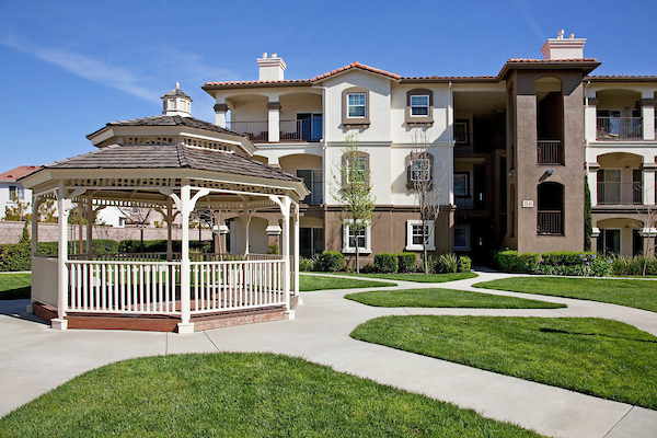 Exterior of apartment homes featuring gazebo and walking paths.