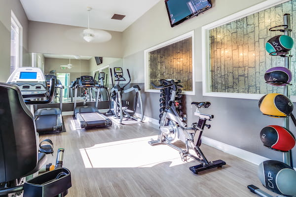 Fitness center with cardio and strength training equipment.