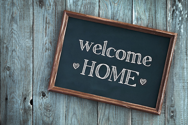 Sign that reads welcome home.