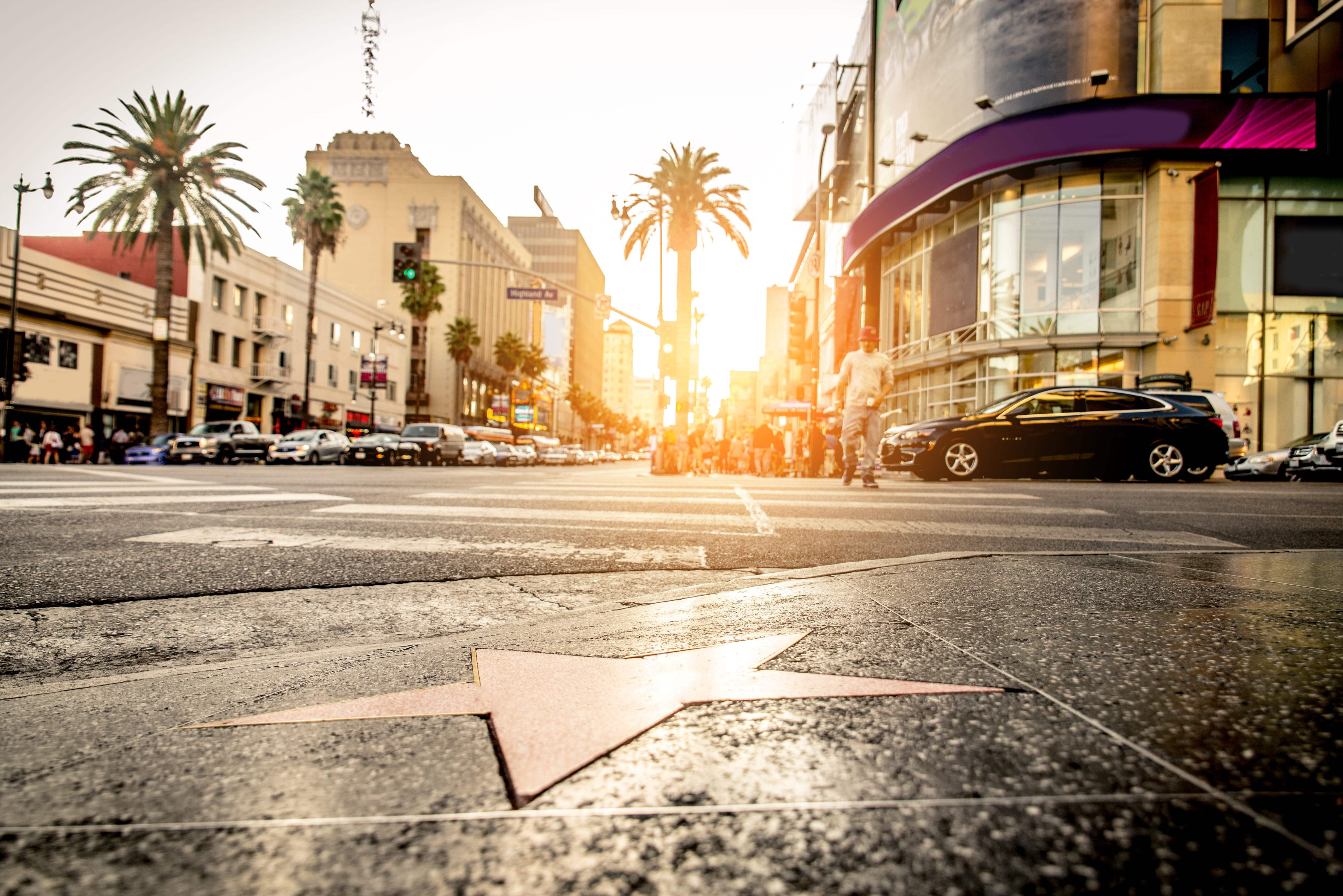 Hollywood star on sidewalk at sunset.