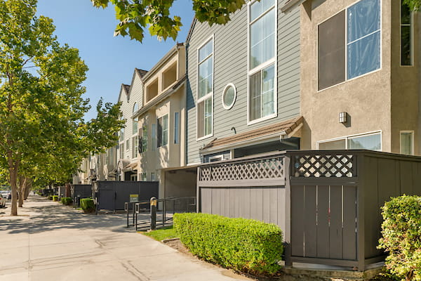 Pathway between apartment homes and landscaping.