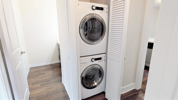 In-unit stacked washer and dryer in closet.