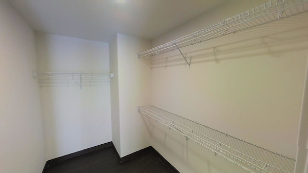 Large walk-in closet with shelving.