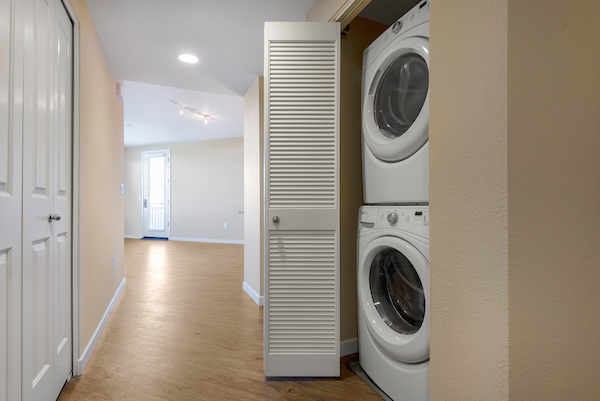 In-home washer and dryer in hallway closet.
