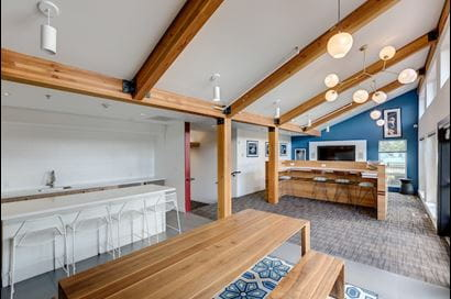 Recreation room with an air hockey table and two arcade machines.