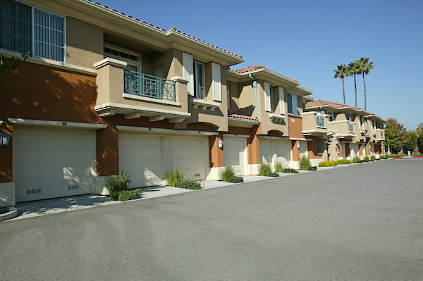 Exterior view of apartment homes featuring garages.