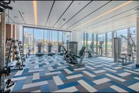 Two story Fitness Center with TVs
