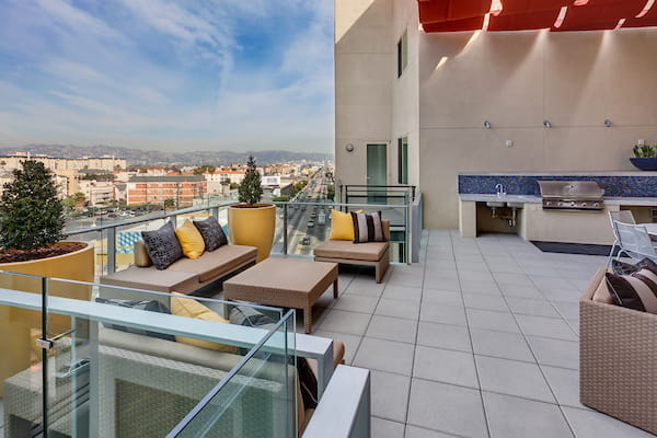 Rooftop terrace with lounge chairs overlooking the city.