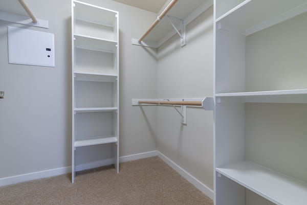 Large walk-in closet with shelving and racks.