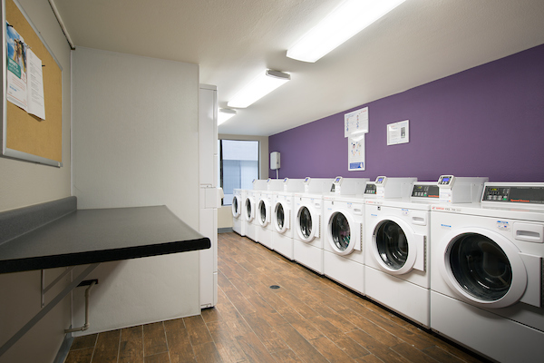 On-site laundry room with washers and dryers.