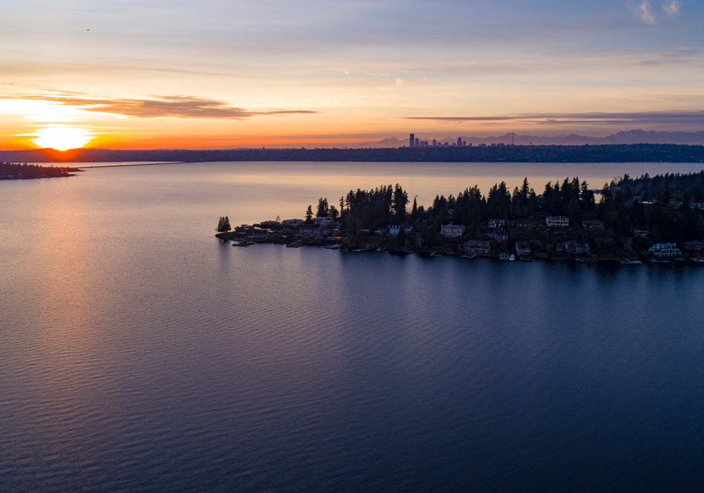 Aerial view of Lake Washington at sunset overlooking Bellevue and Seattle.