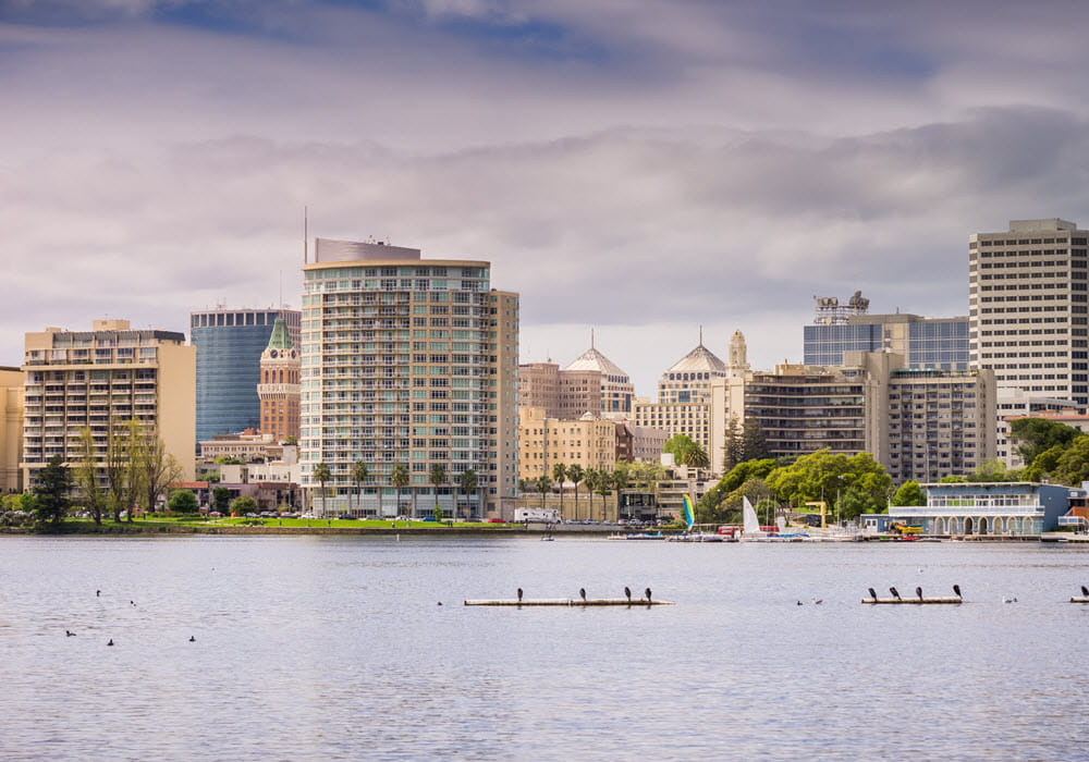 Lake Merritt on a cloudy day with downtown Oakland in the background.