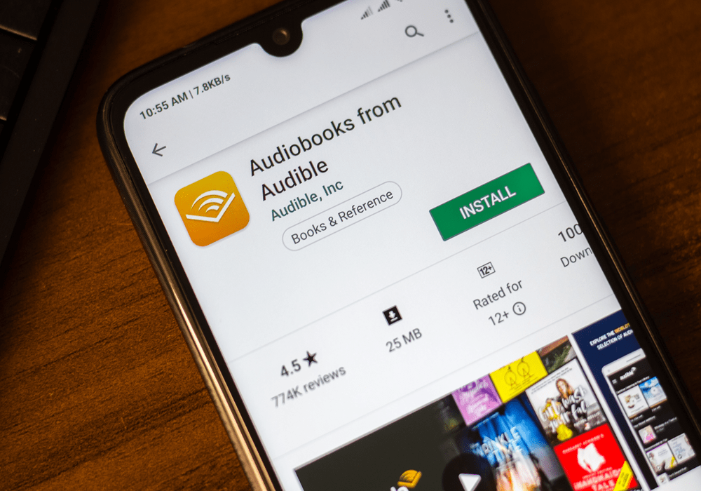 Phone screen featuring mobile app called Audiobooks from Audible