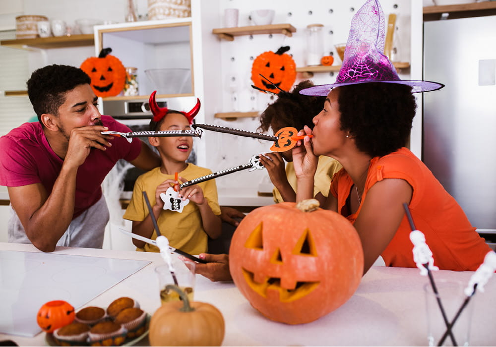 Family of four celebrating Halloween in their apartment home.