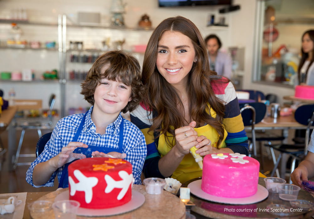 Girl and boy attending a cake decorating class.