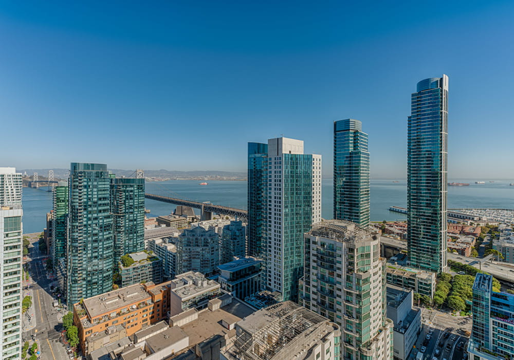 View of San Francisco buildings from a penthouse apartment.