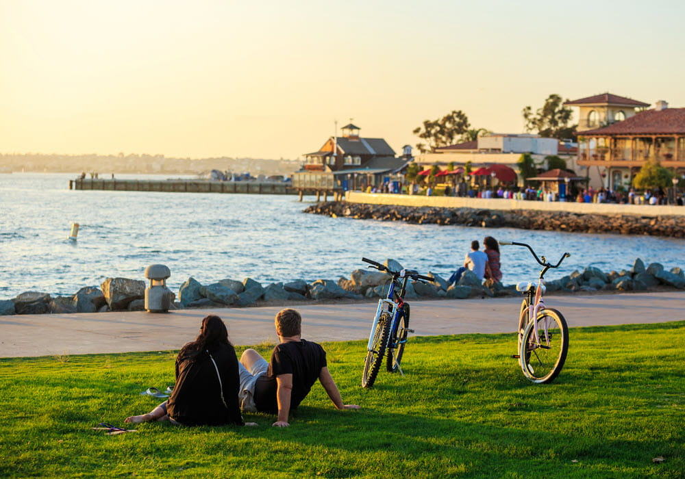 Couple taking a rest from a San Diego sunset bike ride.