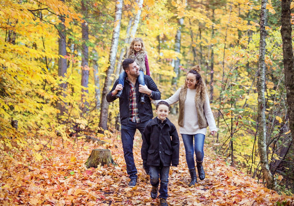 Family of four hiking in the Fall.